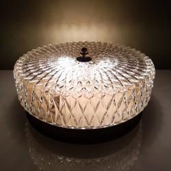 Plafonnier globe en verre et cerclage laiton ajouré