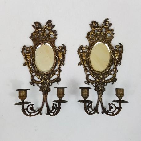 Paire d'appliques chandeliers miroir en bronze décor de chérubins